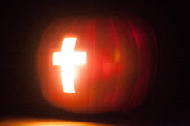 Light of the world pumpkin with cross of Jesus - cross carved in a Jack-O-Lantern pumpkin