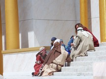 Jesus meeting with some of His followers ministering to them in front of one of the temple synagogues in Jerusalem.