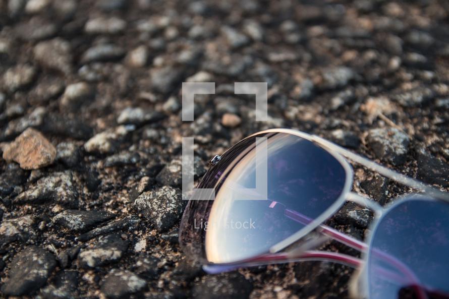 sunglasses on pavement