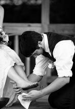 groom washing his brides feet