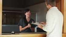 a receptionist greeting a patient in the office