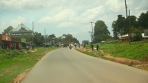 driving through a city village in Kenya