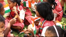 school girls in India waving flags