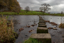 Stepping stones on a public footpath crossing the River Hodder near The Inn at Whitewell, Lancashire, England, United Kingdom