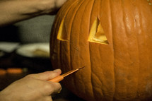 carving pumpkins for Halloween