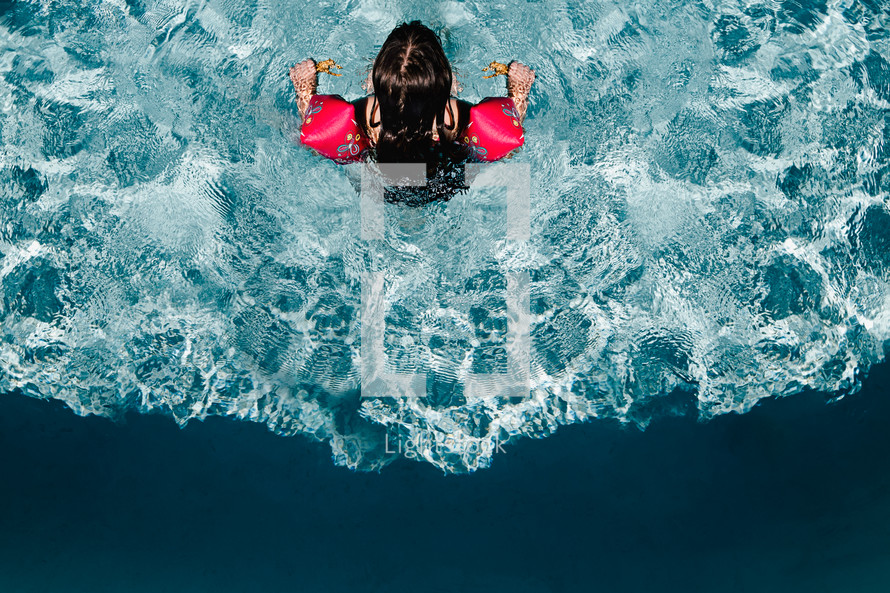 a girl swimming in a pool