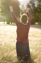Woman Praising God in Field