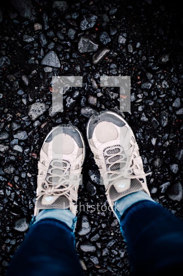 sneakers standing in gravel