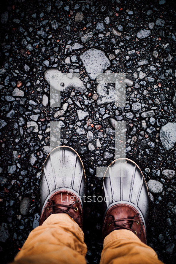 rubber boats standing on gravel
