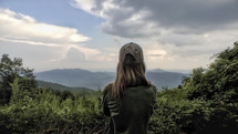 woman looking out at clouds over the Blue Ridge Mountains