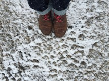 boots standing in snow