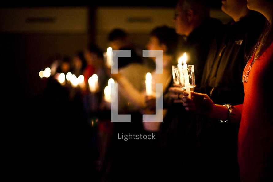 Christmas Eve service - a row of members holding candles