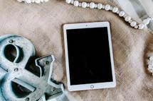 tablet, burlap fabric, and & symbol