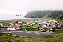 red roof church and homes in a coastal town in Iceland