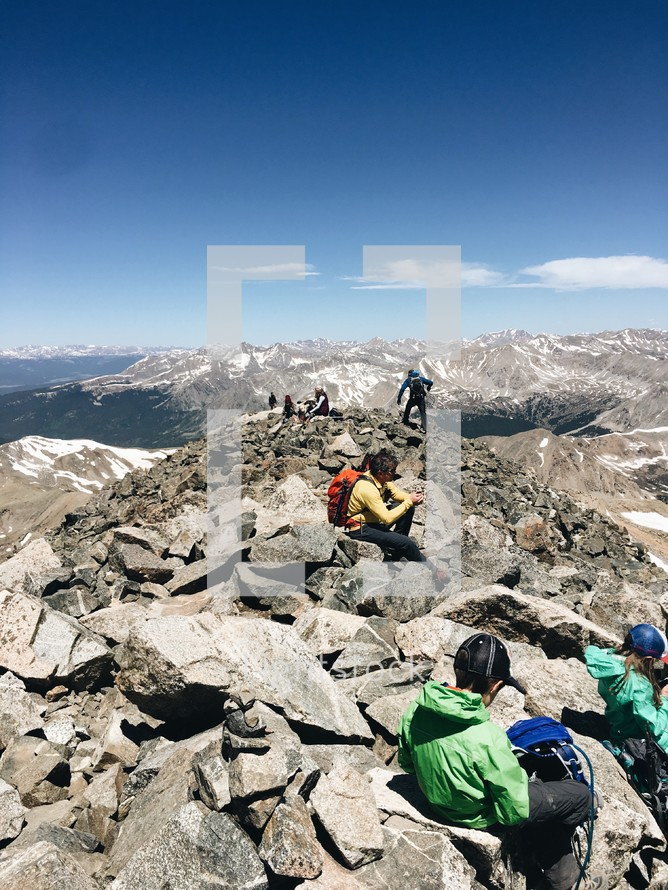 hikers resting on a mountaintop