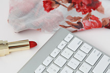 floral scarf, red lipstick, and computer keyboard