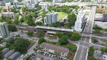 Aerial Orbit View of Train Station In Downtown City
