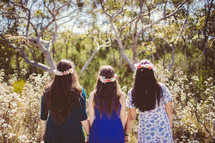 Three girls holding hands in the woods - friendship