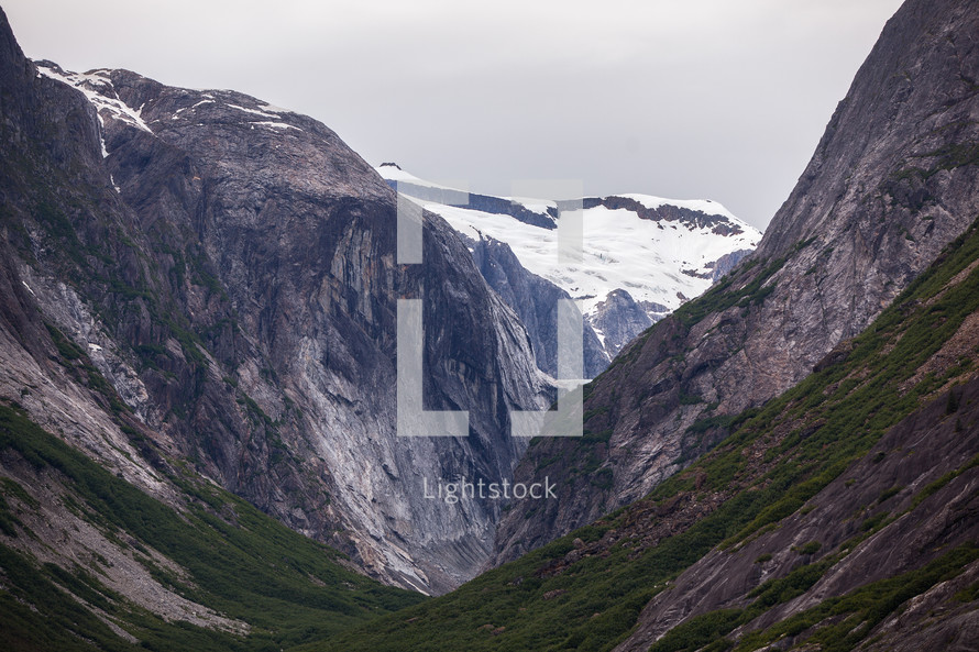A glacier capped mountain ridge at the back of a hanging valley in Southeast Alaska