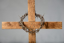 Crown of thorns on a wooden cross.