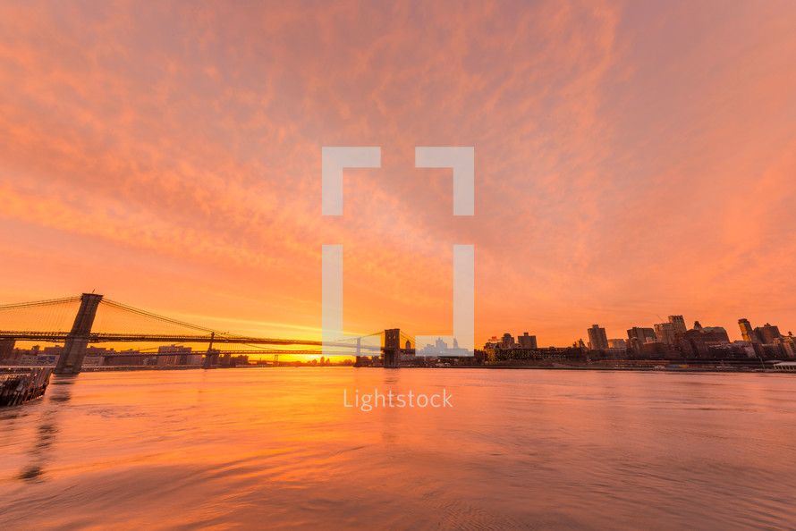 bridge over water in NYC at sunset