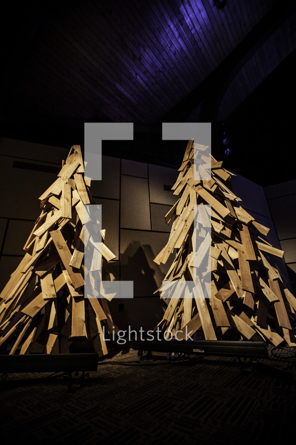 Two Christmas trees constructed of wooden boards.