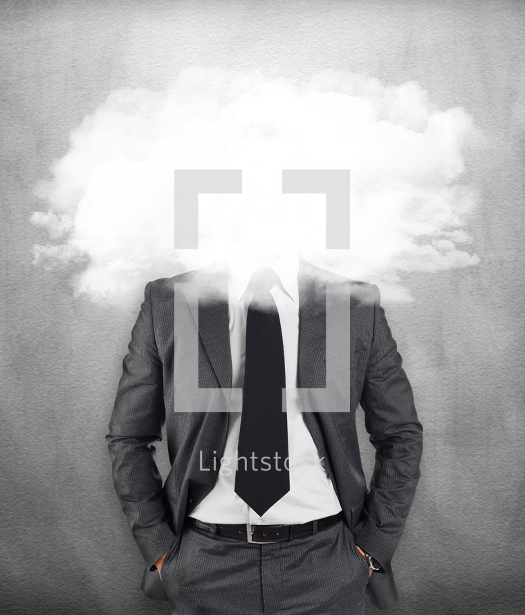 businessman on gray background with head in the clouds
