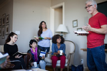 A man leading a small group in a Bible study.
