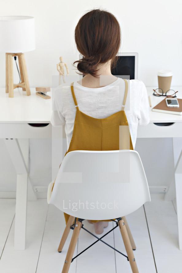 a female sitting at a desk