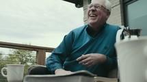 elderly man laughing