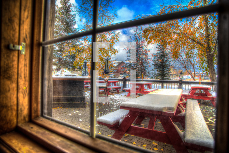 start of winter in Canadian Inn with snow on picnic tables