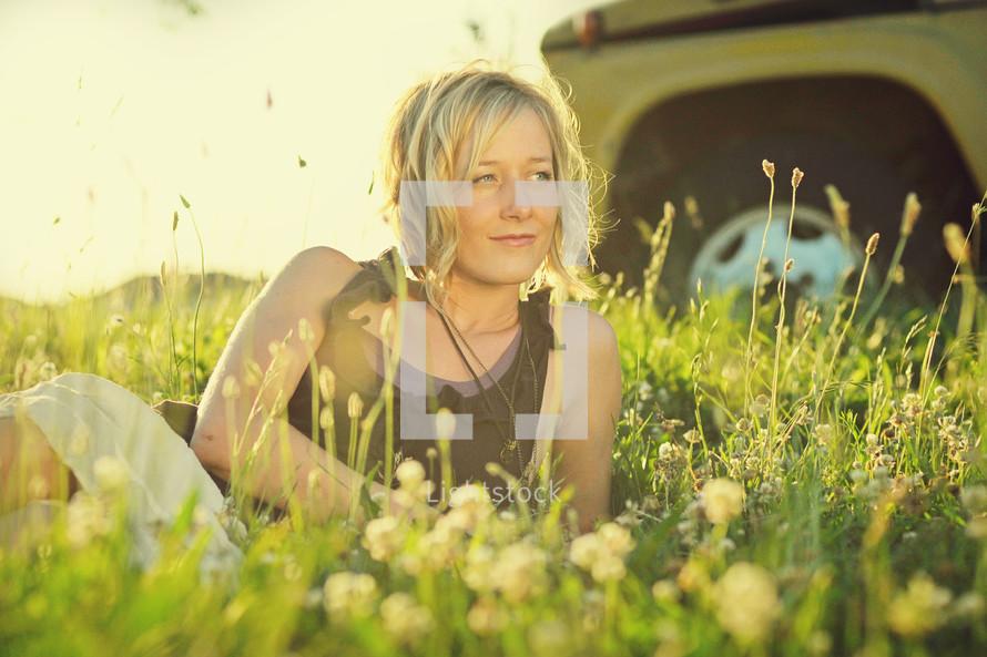 Woman lying in wildflower field