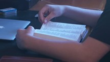 a young man reading a Bible