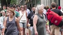 crowds on a busy city sidewalk