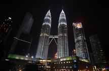 The Petronas Twin Towers in Malaysia at night - Editorial use only