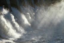 Water spilling through a dam