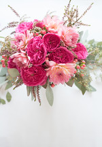A bouquet of pink flowers on a white background.
