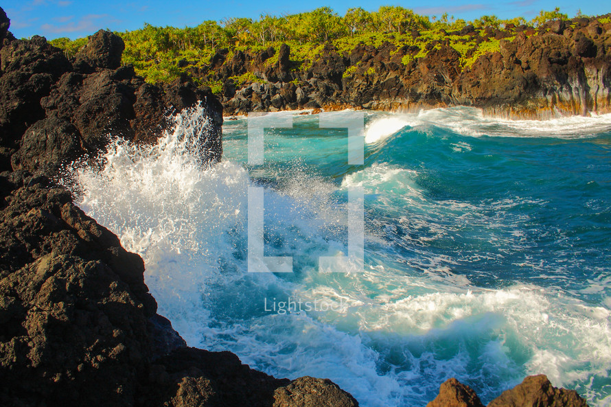 Waves crashing against cliffs