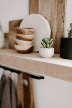 wooden bowls on a shelf