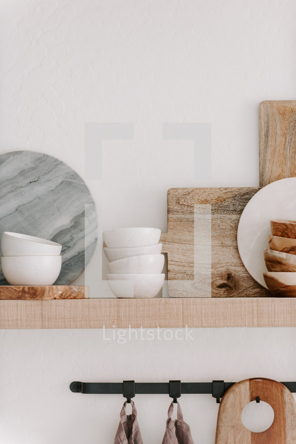 Marble Cutting Board And Bowl On A Wood Shelf Photo