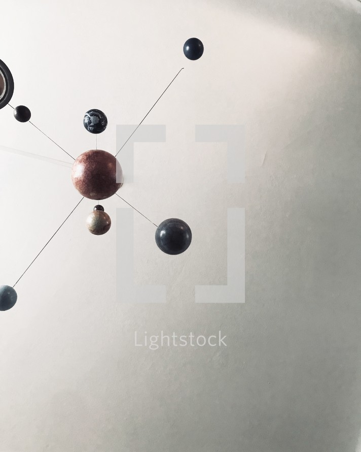 planet mobile on a ceiling