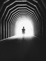 a woman walking into the light