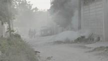 burning trash on the streets of Haiti
