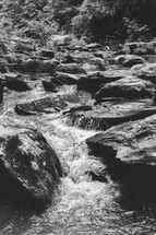 water cascading over rocks in a creek