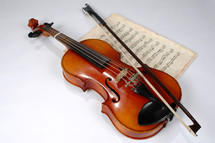 violin, bow, and sheet music