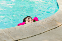 girl child at the edge of a pool