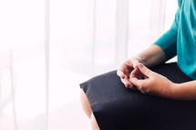 nervous hands in a woman's lap