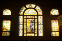 A wall of decorative stained glass windows.