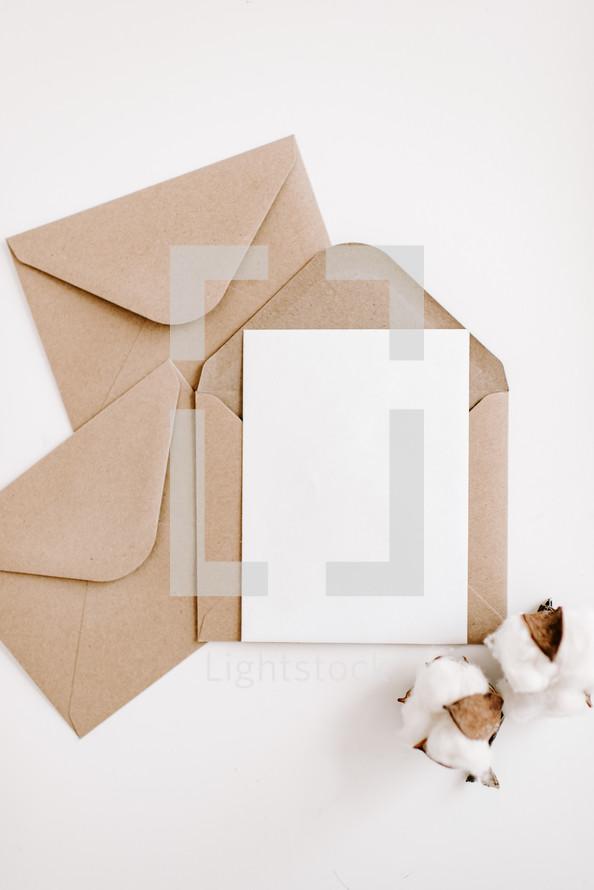 brown and white envelopes on white