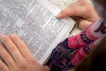a child reading a Bible